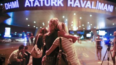 Passengers embrace each other at the entrance to Istanbul's Ataturk airport, early Wednesday, June 29, 2016 following their evacuation after a blast. Suspected Islamic State group extremists have hit the international terminal of Istanbul's Ataturk airport, killing dozens of people and wounding many others, Turkish officials said Tuesday. Turkish authorities have banned distribution of images relating to the Ataturk airport attack within Turkey. (AP Photo/Emrah Gurel) TURKEY OUT
