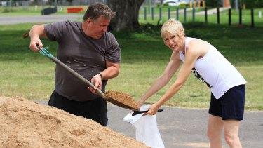 Karen and David Baldwin fill sandbags for their home and their kids'.