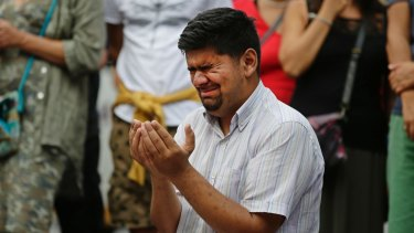 A man cries as he prays by a memorial  to  victims of this month's Barcelona attack.