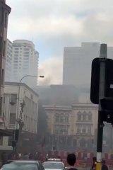 Three people were taken to hospital for smoke inhalation.