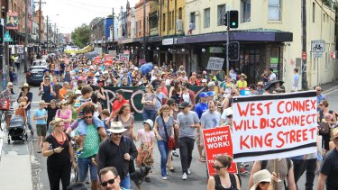 Concerned residents take to the streets of Newtown, Sydney, on Sunday to protest the proposed development of the NSW government's WestConnex tunnel and road project.