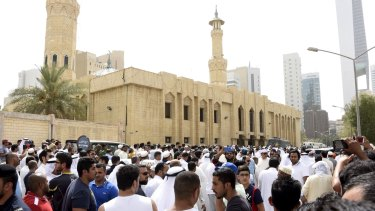 Crowds surround the Imam Sadiq Mosque after the explosion.