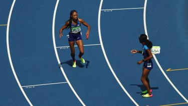 The aftermath: Allyson Felix of the United States picks up the baton and hands it to English Gardner.