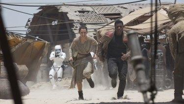 Rey (Daisy Ridley) and Finn (John Boyega) in <i>Star Wars: The Force Awakens</i>.