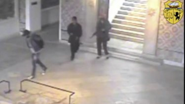 Two gunmen and third unidentified man can be seen inside the Bardo museum in Tunis, during attack in March.