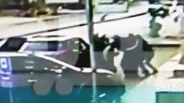 This image shown by the Nine Network shows men allegedly attempting to abduct Sally Faulkner's children from a Beirut street.