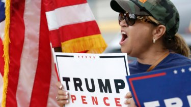 Angry and mobilised - but to where? Donald Trump supporter outside a rally for Democratic presidential candidate Hillary Clinton in Miami.