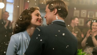 Marion Cotillard with co-star Brad Pitt in <i>Allied</i>.