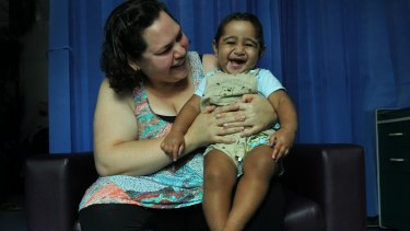 Melita Tawalo holds her son Kini, who received a life-saving bone marrow transplant.