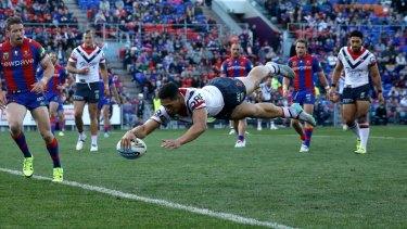 Acrobatic: Roger Tuivasa-Sheck plants one down against Newcastle last weekend.