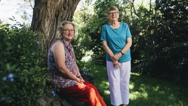Mother and daughter, Thea Foster and Bronwyn Barnard in the backyard of the the family home under the Robina Pseudoacacia tree which inspired a memorial for those who lose their lives to illicit drugs.