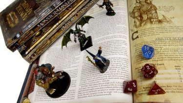 Books, die, figurines from Dungeons and Dragons.