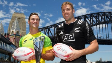 Team captains Ed Jenkins, Australia, and Tim Mikkelson, New Zealand, pose for a photograph for the World Rugby Sevens Series in front of the Sydney Harbour Bridge.