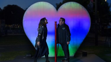 "Jess Scully and Ignatius Jones try the ""I Love You"" installation at Circular Quay.  Vivid opens on Friday 27 May."