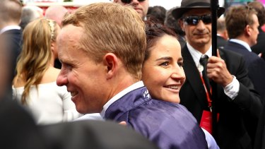 Kerrin McEvoy is congratulated by last year's Melbourne Cup winner, his sister-in-law Michelle Payne.