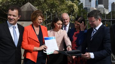 Premier Gladys Berejiklian and Roads Minister Melinda Pavey, second from left, have committed to the first three stages of the F6 extension.