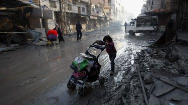 Years of civil war have destroyed normal life for the people of Syria. Here, a child makes her way past the remnants of destroyed buildings in Damascus.