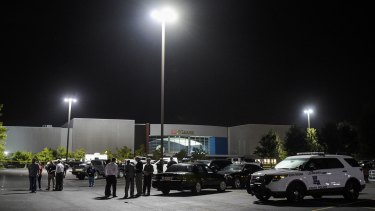 "The parking lot outside the cinema. The investigation  was briefly halted when police found the gunman's vehicle and found what they said was a ""suspicious package"" inside."