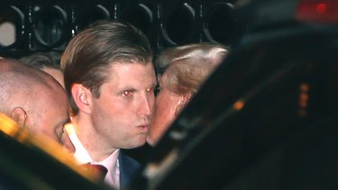 President-elect Donald Trump, right, kisses his son Eric farewell after dining at the 21 Club in New York on Tuesday.
