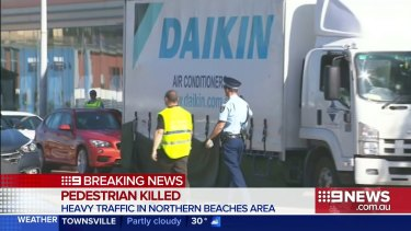 A female pedestrian has been killed after being hit and dragged along the street by a truck on Sydney's northern beaches.