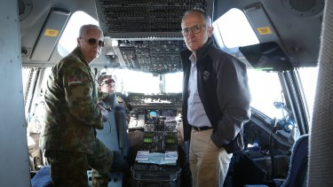 Chief of the Defence Force Air Chief Marshal Mark Binskin and Prime Minister Malcolm Turnbull in discussion on the flight deck of a C-17 Globemaster during their flight to Iraq.