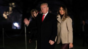 US President Donald Trump, with first lady Melania Trump and their son Barron Trump, returns to the White House on January 1.