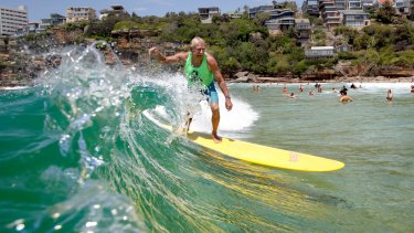 Australia's first surfing world champion, Midget Farrelly shows his style at Freshwater Beach as part of a celebration to mark 100 years of surfing.