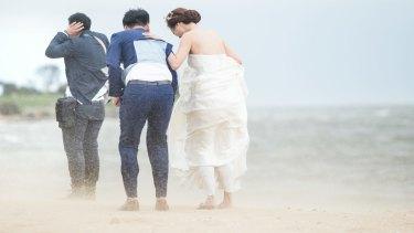 Newlyweds Kate and Michael on Brighton Beach.