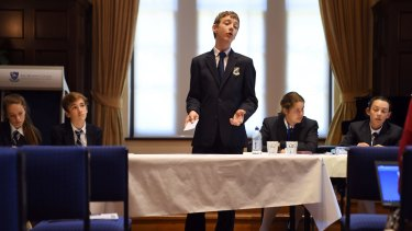 Norfolk student Harrison Hayes speaks at the Premier's Debating Challenge State Championships at Sydney University.