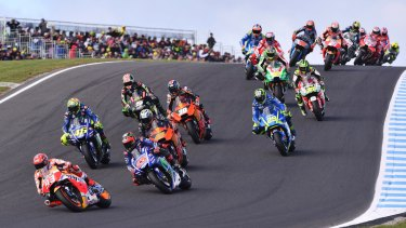 Off to a flier: Spanish rider Marc Marquez leads from the front through the first corners after securing pole position.
