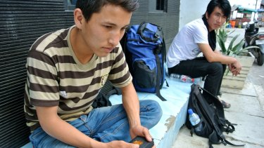 """Homeless: Sardar """"Sammy"""" Hussein, originally from Afghanistan, is camped out in front of the UNHCR office in Jakarta."""