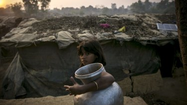 A girl carries a water jug in a Rohingya refugee camp in Cox's Bazar, Bangladesh.
