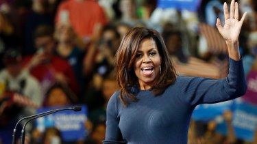 First lady Michelle Obama arrives to a cheering crowd during a campaign rally for Democratic presidential candidate Hillary Clinton.