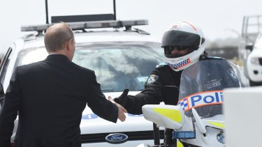 Russian President Vladimir Putin thanks officers as he leaves Brisbane.
