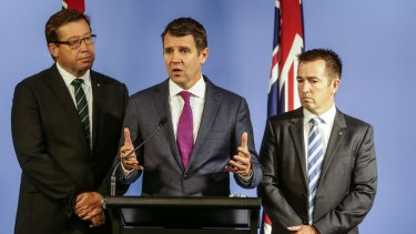 The greyhound ban is weighing heavily on Deputy Premier Troy Grant, left, and Premier Mike Baird.