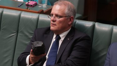 Any takers? Treasurer Scott Morrison brandishing a lump of coal during question time last week.