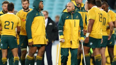 Miserable outing: Matt Giteau hobbled out of ANZ on crutches.