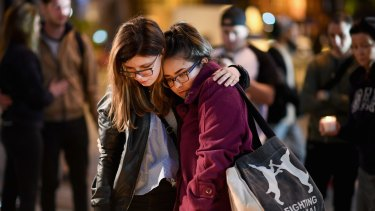 Members of the public at a vigil for the victims of the terror attack at the Ariana Grande concert in Manchester. The victims were primarily girls and women.