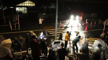 Media members gather in front of Tsukui Yamayuri En care home in Sagamihara, Japan.