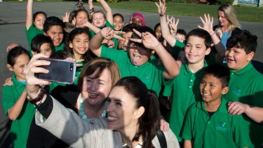 Ardern poses for a selfie with students in Christchurch.
