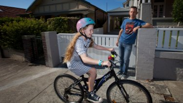 Callum Gordon with his daughter Macy Gordon-Heywood, who rides to school every day.