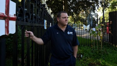 Australian Federal Police Senior Sgt Rod Anderson who was the head of the Disaster Victim Identification team at the MH17 crash site and later in The Hague, stands at the front gates of Hilversum military base where the bodies of the MH17 victims were brought once they landed in the Netherlands and where the DVI proccess took place. Hilversum, Netherlands.