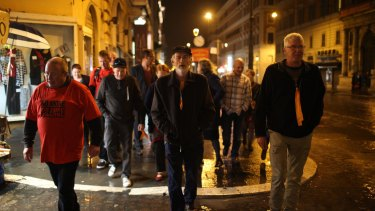 Abuse survivors walk towards the Hotel Quirinale to attend the hearing of Cardinal Pell's evidence in Rome.