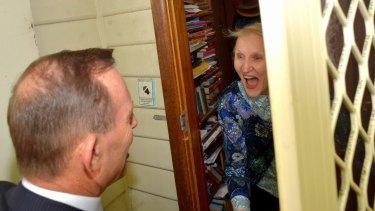 PM Tony Abbott presents the first of the public tickets to the Gallipoli centenary to Cecilia Cornish.
