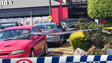A blue Ford Mondeo parked outside the Helensvale McDonald's may be linked to the fatal shooting of a woman.