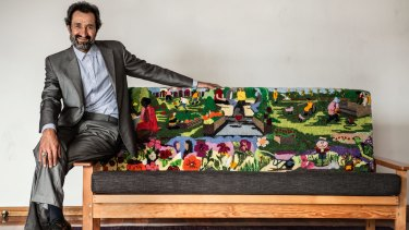 Sayd Shahmamood Abdali and the tapestry couch he helped craft.