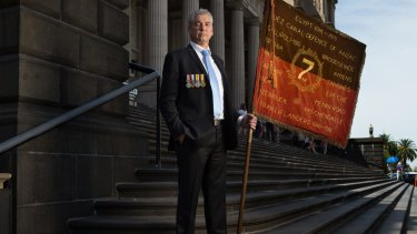 Convener of the World War I 7th Battalion Association, David Laird, says WWI descendants should be able to march with battalion banners on Anzac Day.