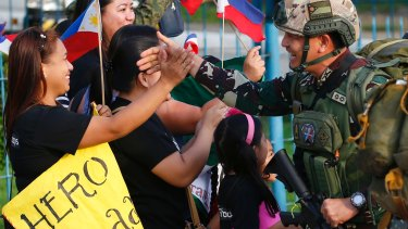 One of the first battalions to be deployed in the besieged city of Marawi in southern Philippines, arrives to a hero's welcome at Villamor Air Base in Pasay city southeast of Manila.