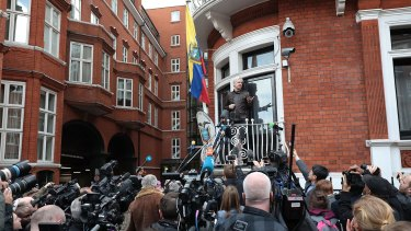Julian Assange speaks to the media from the balcony of the Embassy Of Ecuador on May 19, 2017 in London.