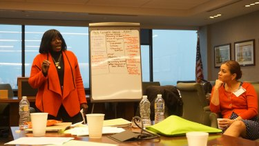 Celia King, chair of the board of Emerge New Jersey, talks to the new recruits at a training session.